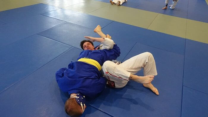 Triangle choke from the side. I let go of his arm you can't see and did a kimura on his arm you can see.