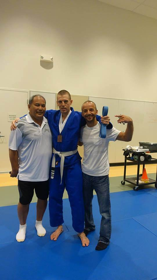 Getting promoted to blue belt. Sensei, myself and Samir. Both are judo and jiu-jitsu teachers at CCSF.
