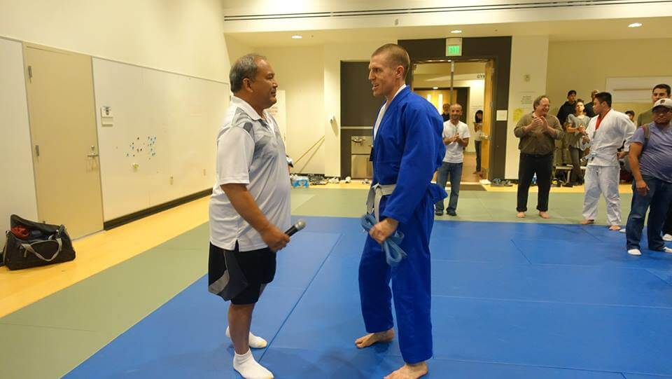 Sensei promoting me to blue belt