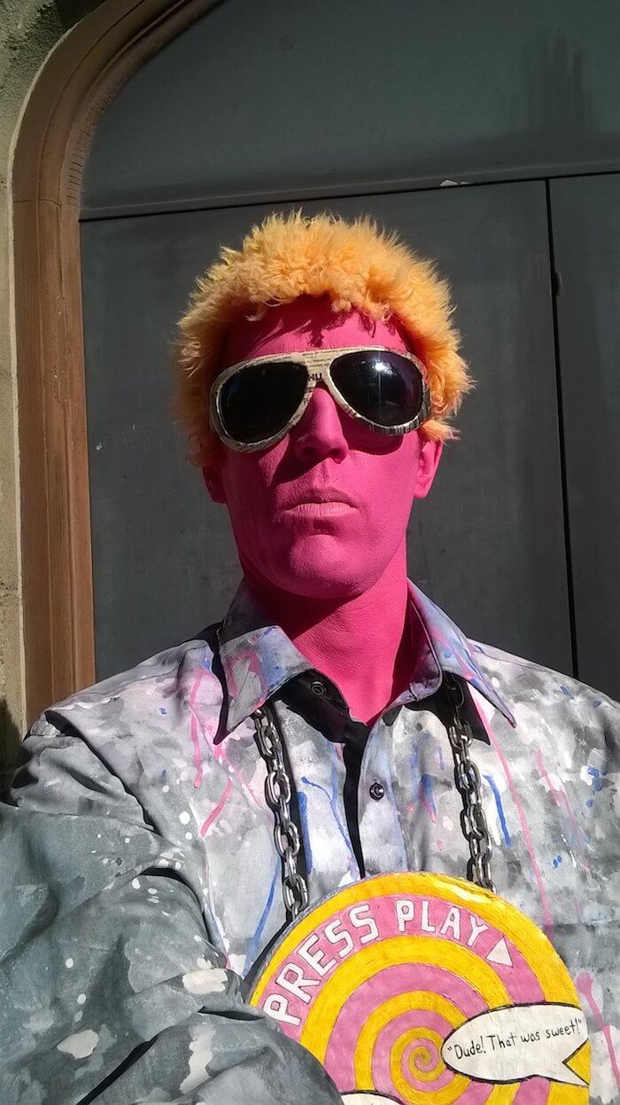 pink man street performer